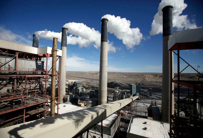 Steam rises from the stakes of the coal-fired Jim Bridger Power Plant outside Point of the Rocks, Wyo. in 2014